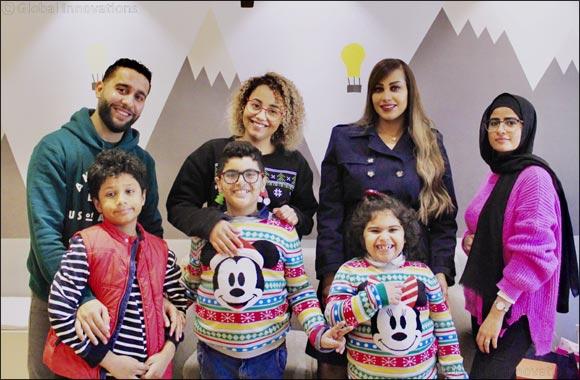 Burgan Bank Distributes Gifts to the Children at Autism Partnership Kuwait
